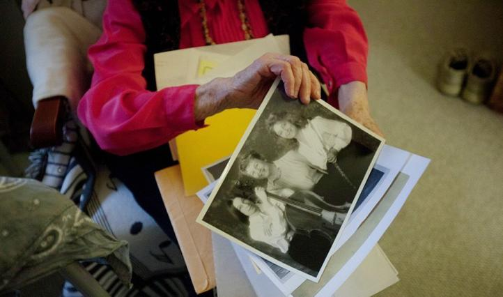 woman holding old photos