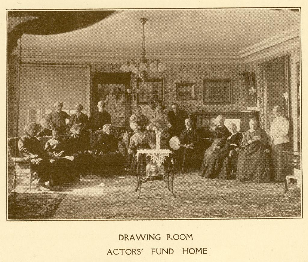 Residents gather in the drawing room at The Actors Fund Home, Staten Island, c. 1917. | Photo by The Actors Fund
