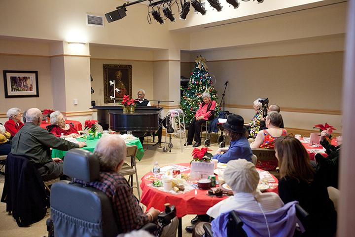 Residents enjoy a sing-a-long anytime, especially during the holidays! | Photo by Claudio Papapietro