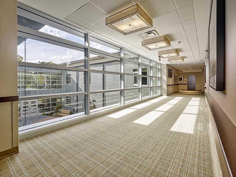 The building was designed to maximize natural lighting through expansive windows with views of the six-acre campus. | Photo by Don Pearse Photographers, Inc.