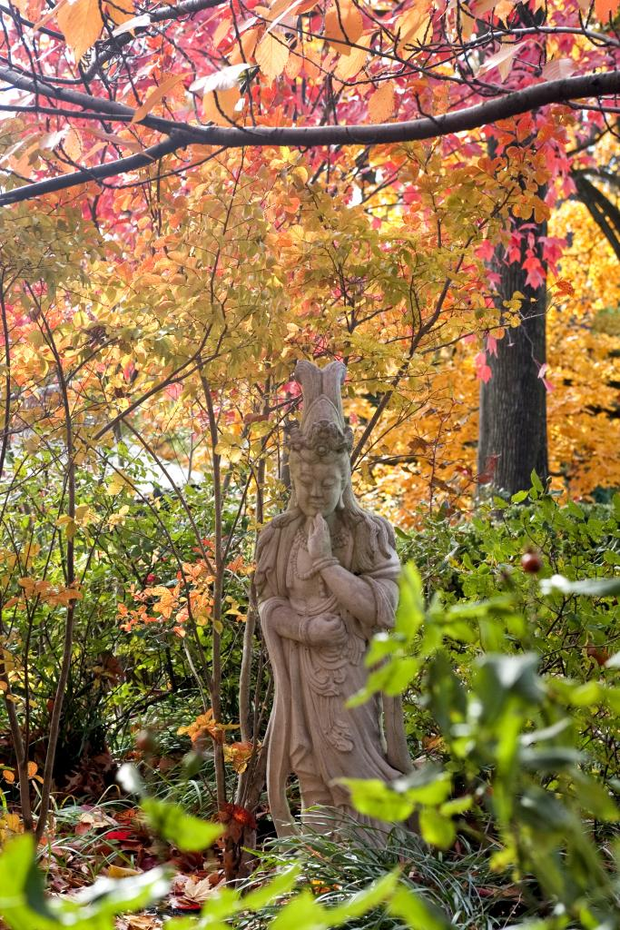 Discover delightful statues on a walk in our gardens. | Photo by Joann Coates